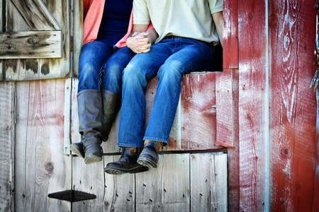 barns: Couple Next to Old Barn Holding Hands Love and Romance
