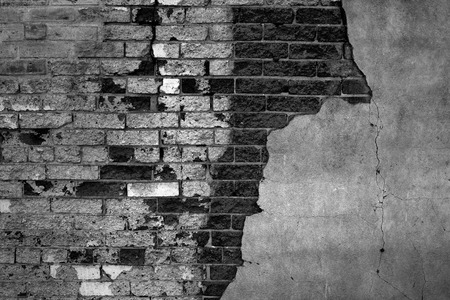 surface level: Gray bricks on plastered wall that is falling apart Stock Photo