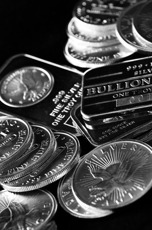 silver coins: Wealth represented by silver coins and bars money