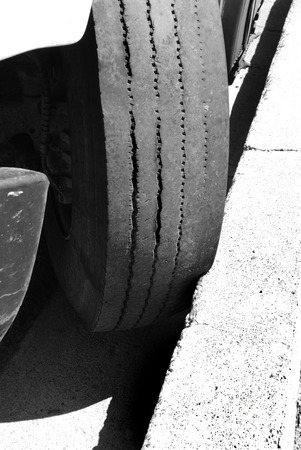 scarred: Car parked against curb not moving with tire against cement Stock Photo