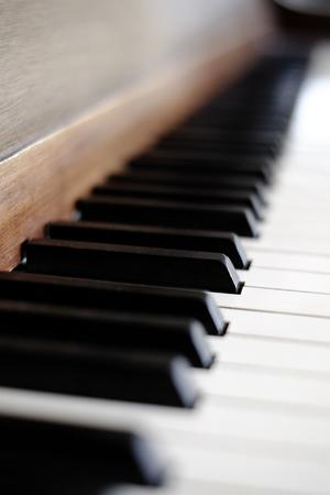 transcription: Piano keys on old vintage instrument ivory & ebony