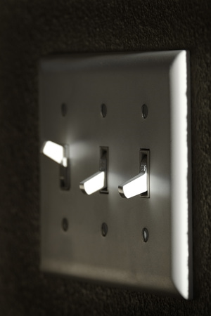 alternative living: On and off light or power switch on wall with highlights