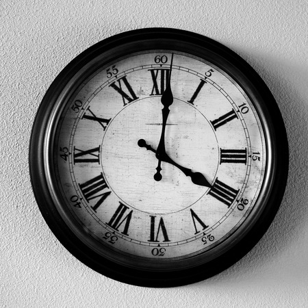 old time: Old vintage clock hanging on wall for time