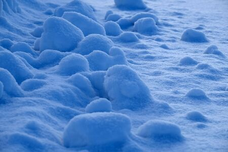 Freshly fallen snow on ground with plowed snow in piles Stock Photo