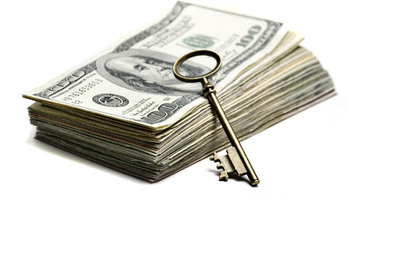 represented: Wealth and riches represented by cash money and a key Stock Photo