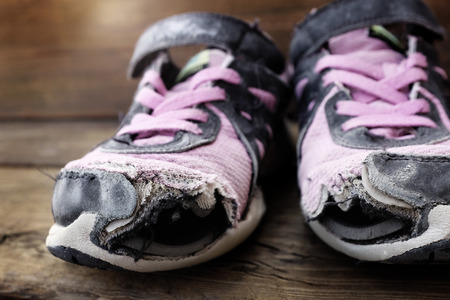 tatter: Worn out old shoes with holes in the toes used by homeless child
