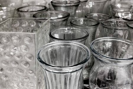 Row of antique glass vases for display on shelf