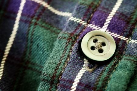 cadet blue: Closeup of button on plaid flannel shirt Stock Photo