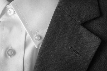 tailored: Closeup of suit buttons and lapel for business or formal wear