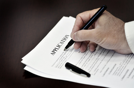obligated: Document loan or contract on a desk with a black pen