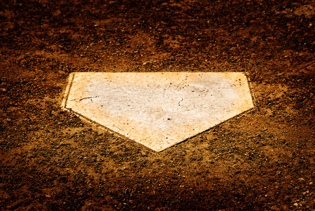 Home plate on baseball diamond for batter to score points Stock Photo