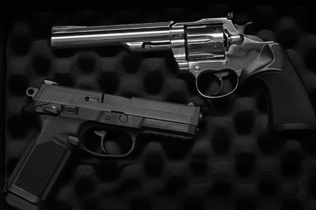Closeup of two pistols handguns trigger for shooting self defense or military 写真素材