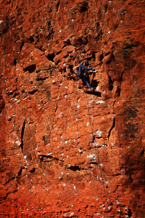 rockclimber: Rock climbing on red sandstone for sport recreation challenge and fun Stock Photo