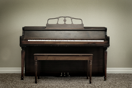 Old vintage piano in home for music Banco de Imagens