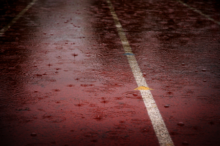 sopping: Heavy rain drops falling on race running track delaying competitions