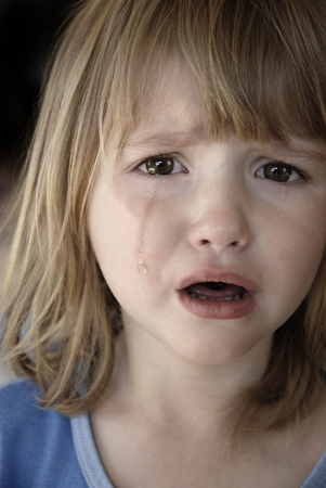 Little girl crying real tears running down cheeks Stock Photo
