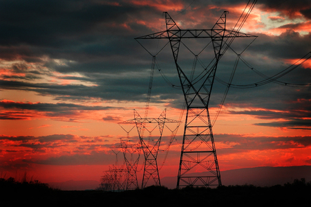 isolator: Landscape of power lines for electricity metal towers and sunset