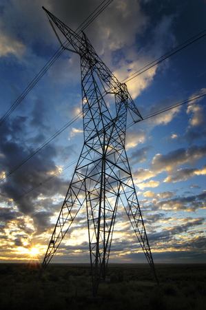 transformator: Landscape of power lines for electricity metal towers and sunset