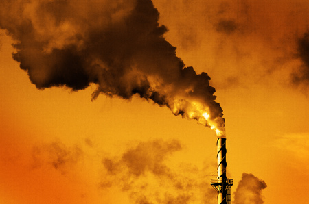 tall chimney: Factory smokestack chimney piping smoke or steam into the air pollution Stock Photo