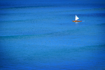 oceanic: Sailboat sailing on calm blue ocean water Stock Photo