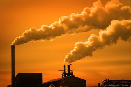 Pollution and smoke from chimneys of factory or power plant Stock Photo