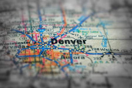 Travel to locations on map views paper destinations to Denver Colorado Stock Photo