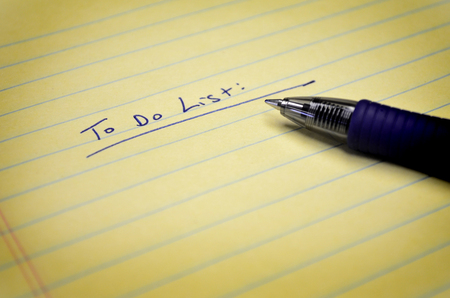 post: To do list on paper pat with pen in ink Stock Photo