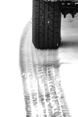 winter tires: Truck tire in snow with tread for safety