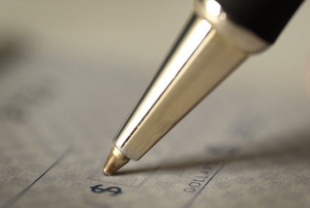 Signing a Check for Personal Finances Stock Photo
