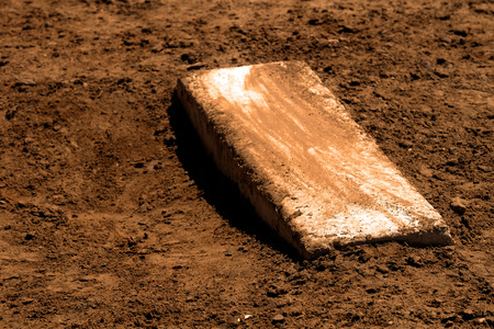 Old worn pitchers mound baseball with fresh dirt Stock Photo