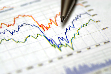 Graphs and pen for financial or stock market charts Stock Photo
