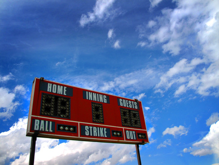 Baseball scoreboard and blue sky for game day