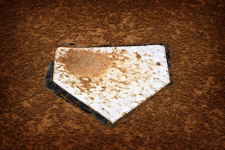 passtime: Baseball home plate base in rich fresh dirt