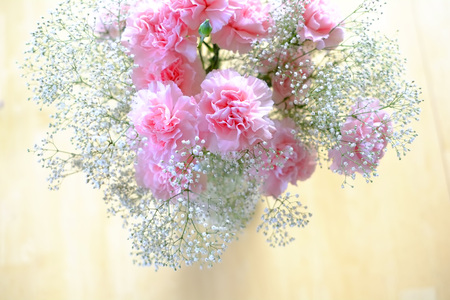 Pink Carnation Flower Boquet on Wooden Contry Table