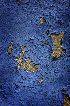 blocky: Chipped and Dried Blue Paint on side of wall