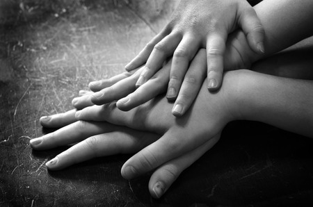 toge: Hands of family or friends showing love and unity Stock Photo