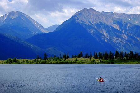 personal perspective: Man on Kayak on Lake Mountains Wilderness Paddling in water