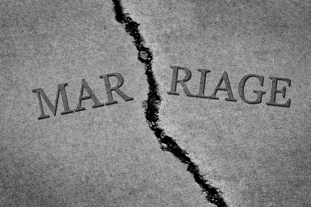 Symbol of broken marriage with crack in concrete concept of end of relationship 写真素材