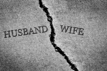 Old cracked sidewalk broken and dangerous cement husband and wife Stock Photo