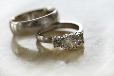Closeup of diamond rings jewelry as symbol for love and commitment