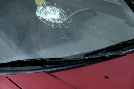 Smashed car windshield on vehicle for transportation