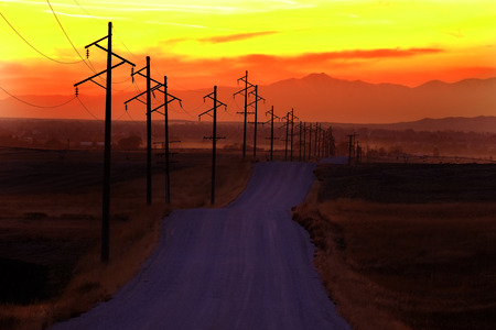 Telephone or power poles in the countryside rural area at sunset sunrise