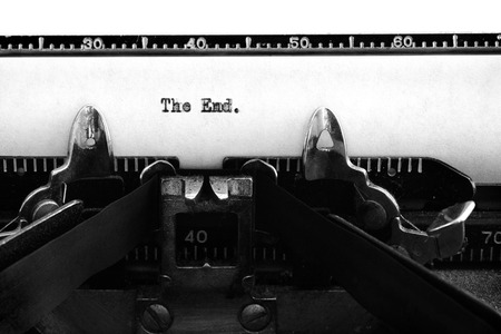 Old vintage typewriter keys and characters with typed words the end for story ending Stock Photo