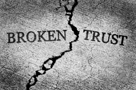 Old cracked sidewalk broken and dangerous cement lost trust untrustworthy