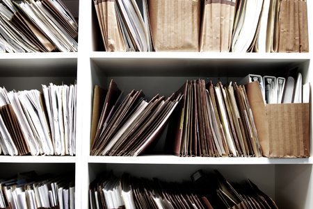 Files on shelf organized for office work legal or medical Imagens