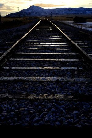 Railroad tracks in warm evening glowing light for traveling Stock Photo