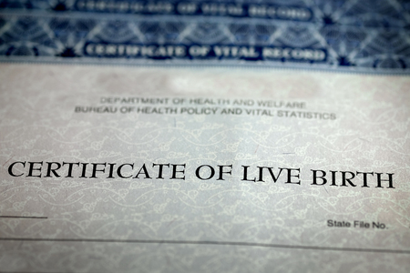 Closeup of Birth Certificate official paper baby born