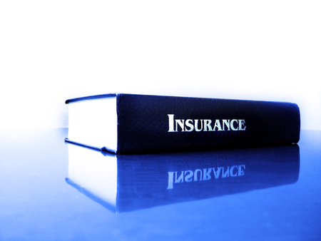 Old leather law book on the topic of insurance Imagens