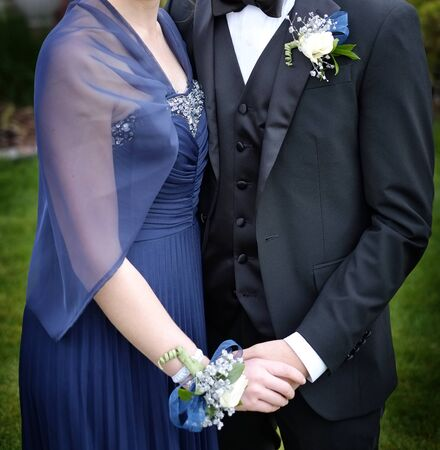 Prom date boy and girl for formal dance with corsage flowers suit dress