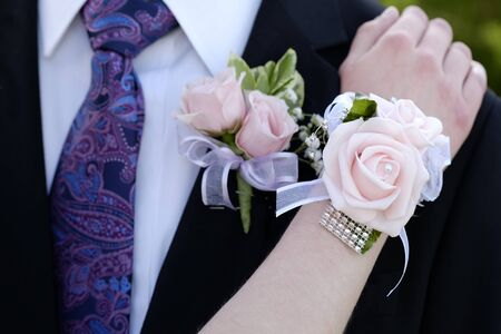 Hands of date Prom night flowers corsage formal wear